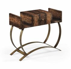 EUGÈNE PRINTZ (1889-1948) ET JEAN DUNAND (1877-1942) TABLE LISEUSE, VERS 1931 En palmier et lames de laiton décorées à l'argenture Hauteur : 59,5 cm. (23 3/8 in.) ; Largeur : 70,5 cm. (27 in.) ; Profondeur : 30,3 cm. (11 7/8 in.)
