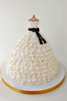 Stunning Wedding Dress Cakes For Your Bridal Shower ❤ Why do we like wedding dress cakes? Covered in pink marshmallows, chocolate buds and dripping with sugar pearls, check spectacular cake designs out here. See more: http://www.weddingforward.com/wedding-dress-cakes/ #weddings #cakes