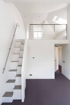 Carlton Hill, London : Minimalist corridor, hallway & stairs by Gregory Phillips Architects