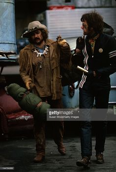 American actor and director Dennis Hopper (1936 - 2010) and actor Peter Fonda walk together during the filming of Hopper's directorial debut 'Easy Rider,' New Orleans, Louisiana, 1968.