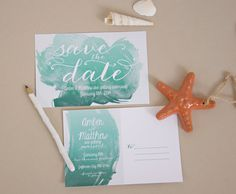 This watercolor Save the Date is beachy with a hint of nautical, featuring a matte save the date postcard. The calligraphy fonts and watercolor