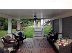 Vinyl deck with @wolfbuilding  PVC Decking using amberwood flooring with rosewood border and white PVC railing.