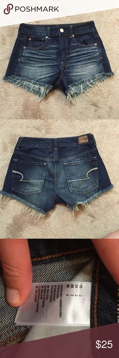 NWOT American Eagle Shorts High waisted American Eagle shorts. Dark wash with a little fringe at the bottom. NEVER worn. American Eagle Outfitters Shorts Jean Shorts