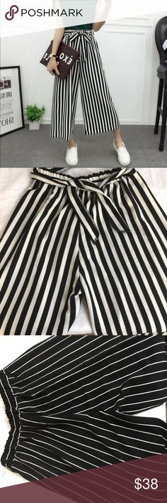 High waist flare wide leg palazzo pants Perfect summer casual/evening/date night/work loose fitting pant with elastic waistband removable belt! Choice of white w/black stripes or black w/white stripes. M-waist stretches from 23-38 Hips 42-L waist stretches from 24-40 Hips 46 inseam 19 rise 13 (hip measurements is maximum meant to fit loose so please order a size up if unsure..) Pants