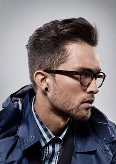 The eyeglasses, the earring, the hair, the scruff, the shirt. / Not much tailoring here, but loads of awesome style!