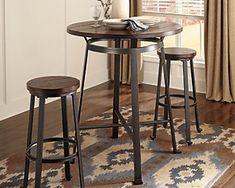 Rustic in feel with modern appeal, the Challiman dining room pub table is styled with fascinating flair. Veneered plank table surface serves up cool distressed character. Sculptural legs punctuated by L-shape feet form the industrial-inspired base. Bar Stool Table Set, Patio Bar Set, Bar Height Table, Counter Height Bar Stools, Pub Table Sets, Bar Tables, Pool Table, High Top Table Kitchen, Kitchen Dining Sets