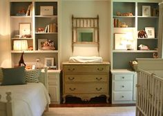 nursery, small dresser changing table, daybed, white crib, bookshelves flanking dresser, built ins with drawers, bookshelf with drawer