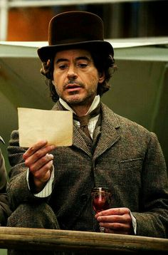 "Those Baker Street boys -- trading clothes again.) wearing Watson's suit and hat while filming ""Sherlock Holmes: A Game of Shadows"" Sherlock Holmes Robert Downey, Robert Downey Jr., Robert Downing Jr, Hero Marvel, Hat Quotes, Guy Ritchie, I Robert, Baker Boy, Arthur Conan Doyle"