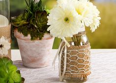 Mason jar wrapped with burlap and chicken wire