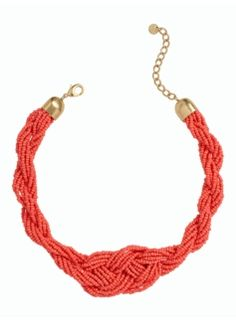With this bold but not bulky piece in bright sun-kissed coral, pop your collar the modern way by adding this eye-catching accent necklace.
