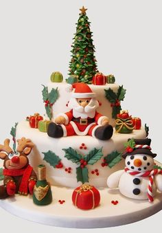 Multi-tierd Christmas Cake with fondant tree, Santa, snowman & Reindeer
