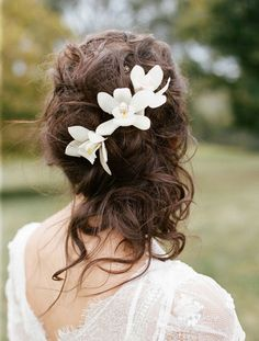 Love the orchid accents in this slightly messy updo ~ we ❤ this! moncheribridals.com