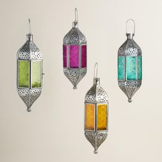 We traveled the world to find our hanging lantern, handcrafted by artisans in India of glass and hand-punched iron with an antique zinc finish. Inspired by Moroccan and Mughal artwork, it makes a global style statement.