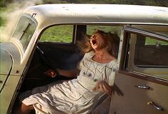Bonnie is gunned down in the ambush by Frank Hamer (played by Denver Pyle).