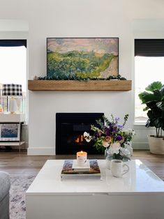 White fireplace and wood mantel are the center piece of our living room. Tv Above Fireplace, White Fireplace, Living Room With Fireplace, New Living Room, Home And Living, Modern Fireplace, Wood Mantels, Fireplace Mantels, Fireplaces
