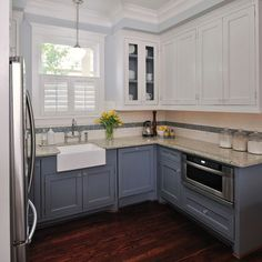 This pic was our inspiration! Lower Cabinets and Island-SW 6249, Storm Cloud Upper Cabinets and Trim-SW 7004, Snowbound Interior of Upper cabinets with glass-SW 6249, Storm Cloud Walls- SW 7071, Gray Screen All paints Sherwin Williams