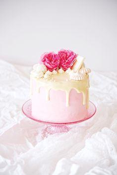 Ginger Malted Vanilla and Hibiscus Cake | ginger malted vanilla cake + hibiscus italian meringue buttercream+white chocolate ganacheglaze + meringues,pink sugar pearls, andcoconutty rafaello truffles | cake decoration | valentine's