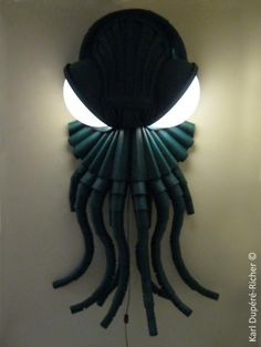Cthulhu Lamp -- love it!  It would be funny to put this out on the first night you have house guests, after they go to bed of course.