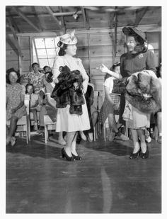 This is a stunning photograph of a fashion show at Tule Lake Relocation Center in Newell, California in September 1942.