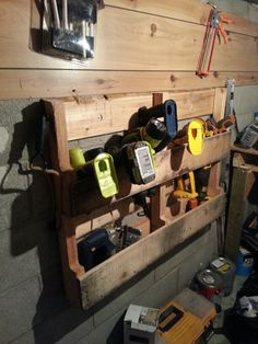 Pallet shelf. Tools get hung and batteries in the bottom.