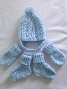 4e60b03fef6 Items similar to Hand knitted baby boy s blue cable and rib helmet hat