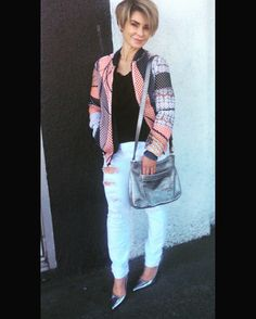 Clover Canyon mesh bomber jacket, Donna Karan black label tshirt, Current Elliot size 27 distressed white jeans, Kate Spade metallic handbag, with Jimmy Choo heels.