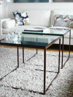 de5 INTIMODEIN: Soffbord Alice Benställningen kan fås i rostfritt stål, lackat står i tex svart eller järn. Skivorna kan fås i glas, skiffer