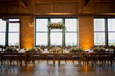 Cristina G Photography. Vale of Enna flowers. Bridgeport Art Center. Pink, Yellow, White, and Green. Centerpiece. Hanging Floral. Chicago Wedding.