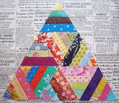 """1 1/2"""" strips of fabric sewn in groups of four then cut into triangles and pieced together."""