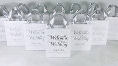 Elegant wedding welcome bags with silver satin ribbon handles and custom names. Chic personalized gift bags for wedding favors for guests. #welcomebags #weddingwelcomebags #giftbags #personalizedgifts #weddingfavor #weddingfavors #weddingbags #weddingfavorideas #weddingparty #favorbags #weddingwelcome #weddingparty #elegantwedding #silverwedding #infinitylove