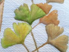 Quilted ginkgo leaves on calico, painted with Derwent Inktense pencils