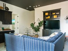 A playful mix of masculine and earthy elements, the media room is the ideal escape to let loose and enjoy movie night.