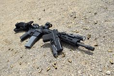 """Another shot from yesterday's EDT testing. One of our host G19s with the Enhanced Optic slide pkg, full frame pkg and Enhanced Duty Trigger. Also running a Bravo Company USA 16"""" rifle with an Aimpoint T1, Troy Industries Alpha Rail & BUIS, INFORCE APL & WML, Impact Weapons Components [Official Fan Page]] handstop & sling mounts, BattleComp 2.0 and a Larry Vickers 2 point sling."""