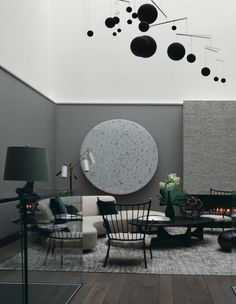 Both the grey circle and the black balls could be used as sound absorbers. Endless possibilities.