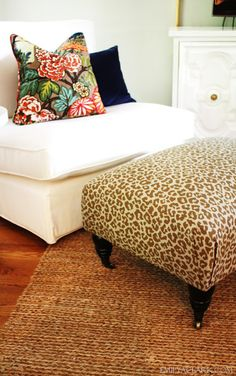 Recovering an ottoman in a leopard print for our living room (and how to make neat corners)  http://emilyaclark.blogspot.com/2012/05/little-leopard-in-our-living-room.html