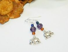These drop-dangle earrings feature Indian Elephants, purple crystals and coloured seed beads on Sterling Silver ear-wires. Lovingly hand-crafted in my workshop in Northern Ireland, elephants have long been thought to be a symbol of good luck so I like to think these will bring good luck to the Silver Drop Earrings, Sterling Silver Earrings, Dangle Earrings, Indian Elephant, Organza Gift Bags, Northern Ireland, Elephants, Seed Beads, Gifts For Her