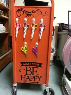The other side of the Makerspace mobile cart. Here we have scissors with different blades all hung on hooks.