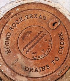 New design for Round Rock, Texas-Parking lot of the Bass Pro Shop. Franklin Park Zoo, Round Rock Texas, Texas Texans, Bass Pro Shop, Drain Cover, Metal Working, Street Art, Markers, Parking Lot