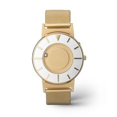 The Bradley Mesh Gold offers a subdued, warm tone softened by a matte finish. Raised markers are brushed with a gold hue that matches the case and strap, highlighted by a light silver face around the markers and gold center.