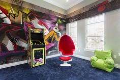 This hidden teen lounge is an awsome addition to any home #goofyroom #suzannenicholsdesigngroup #teenlounge