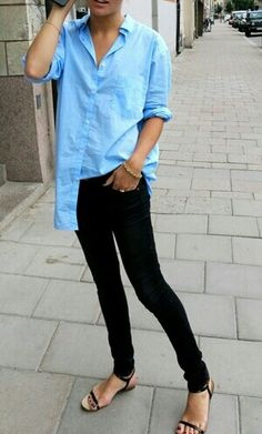 blue shirt, black jeans, flat sandals