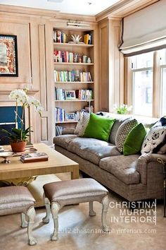 That sofa looks so comfortable + the cute pop of green...