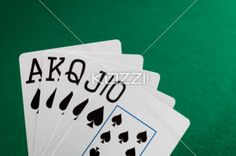 straight flush - Straight flush of spade with green poker table as background.
