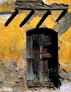 In Guatemala - makes you wonder what's beyond its entrance. Entrance Doors, Doorway, Old Doors, Windows And Doors, Yellow Doors, Closed Doors, Door Knockers, Mellow Yellow, Central America