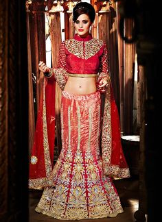 Shop this product from here.. http://www.silkmuseumsurat.in/orange-color-velvet-fabric-fish-cut-designer-lehengha-choli?filter_name=4360  Item :#4360  Color	 : Red Fabric	 : Net, Velvet Occasion	 : Bridal, Party, Wedding Style	 : A Line Lehenga Work	 : Hand Embroidery, Kasab, Patch Border, Resham, Stones