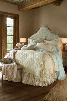 Soft surroundings and many pillows are a great appeal/makes a bed look comfy and homey.