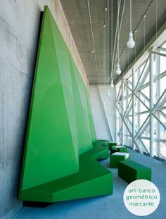 high ceiling + geeometric green bench
