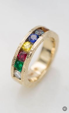 Bringing together all the colors of Thanos& Infinity Gauntlet, this hammered yellow gold wedding ring features emerald, ruby, yellow and blue sap. Ruby Wedding Rings, Custom Wedding Rings, Diamond Wedding Bands, Gold Wedding, Three Stone Engagement Rings, Rose Gold Engagement Ring, Marvel Wedding, Marvel Gifts, Fandom Jewelry
