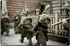 Lauban, Silesia. March 1945. Towards the end of the War, boys as young as fourteen were pressed into service by the Germans. These lads are carrying Panzerfaust anti-tank weapons. Designed to be cheap and easy to mass-produce, more than six million Panzerfausts were produced in the space of three years and were often given to young boys and old men in case they happen across a Russian tank. The effect of a penetrating hit on a tank by a Panzerfaust would be a most unpleasant experience for…