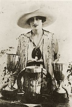 Vera McGinnis, was an early rodeo cowgirl and trick rider. She was the first woman to design and wear her own trousers in a rodeo performance.